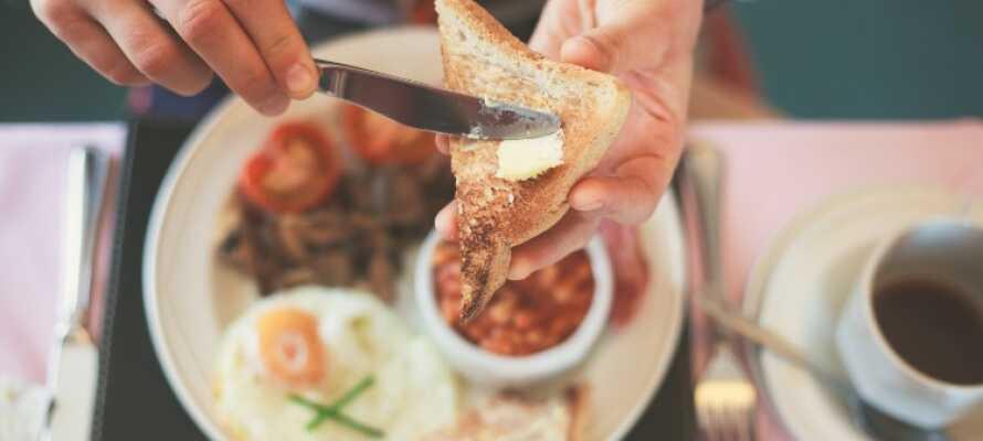 Jeden Morgen serviert das Hotel ein köstliches Frühstücksbuffet. Das Restaurant, serviert alles - von Tagesgerichten bis hin zu À-la-carte-Menues.