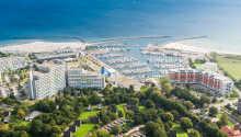 Das Ostseehotel Midgard hat eine schöne Lage am weißen Strand in dem Küstenort Damp in Norddeutschland.