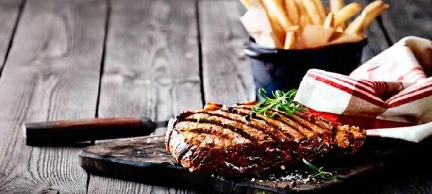 Haben Sie ein schönes Abendessen in Jensen Bøfhus Steak-Restaurant.