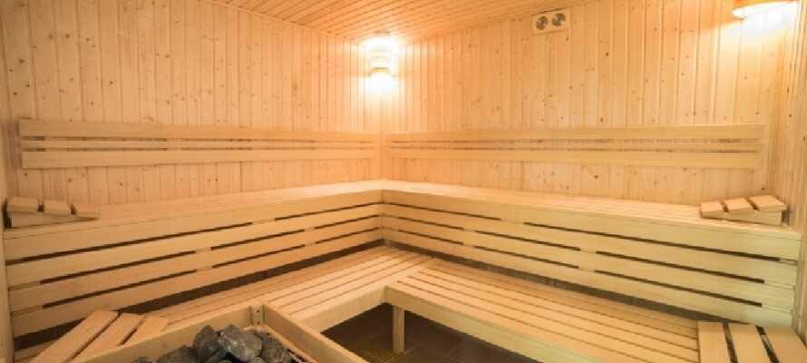Slap af i saunaen efter en lang dag i byen. Gør det ekstra luksuiøst med en massage først1