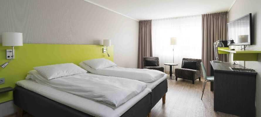 De komfortable værelser på det moderne Thon Hotel Hallingdal har både TV og WiFi.