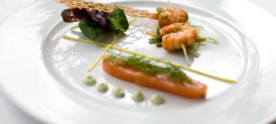 Glæd dig til at spise middag på Restaurant Møllehuset, hvor dine smagsløg er i centrum