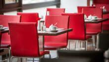 Genießen Sie ein Tässchen Kaffee oder eine gute Mahlzeit im Hotel.