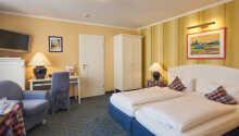 Hotellets komfort værelser er romslige og smagfult innredet