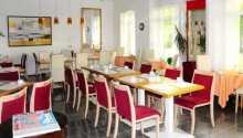 Stå op til morgenmad og hygge i hotellets morgenmadsrestaurant