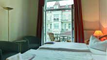 Et eksempel på et dobbeltværelse med balkon.