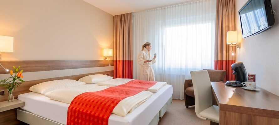 De lyse og rummelige værelser tilbyder en skøn base for Jeres ophold med et højt niveau af komfort.