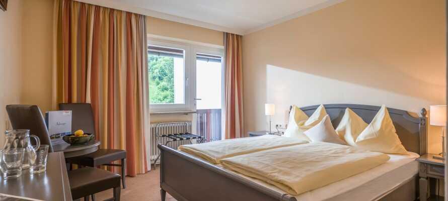 Die Hotelzimmer sind traditionell eingerichtet und bieten 4-Sterne-Komfort