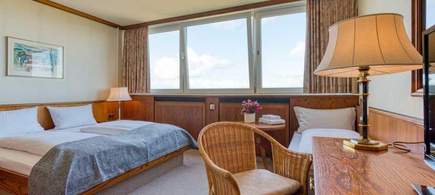 Njut av god sömn och en bekväm bas på hotellrummen.