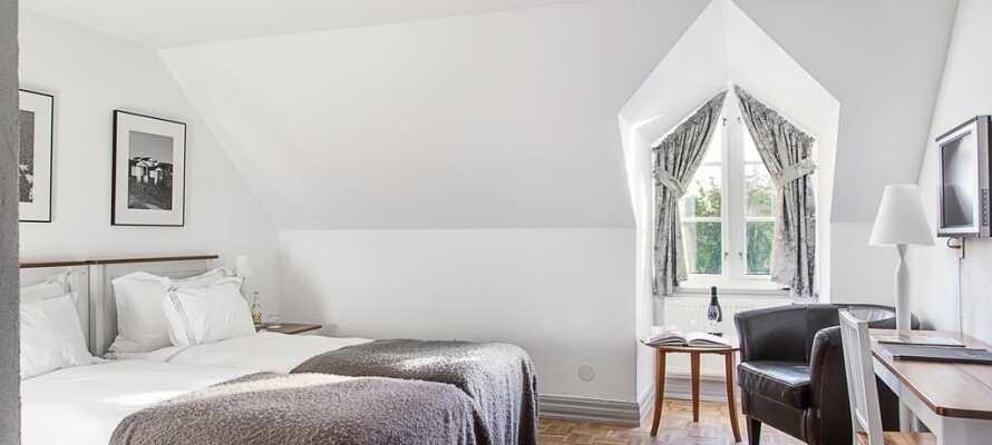 De flotte værelsene er innredet i en skjønn tradisjonell stil med en moderne touch og sans for detaljer