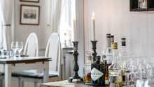 Kroens værelser er innredet i en skjønn tradisjonell stil med en moderne touch