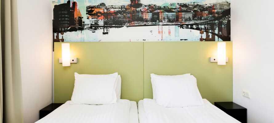 I bor på lyse og enkelt indrettede værelser, alle med eget badeværelse og fladskærms tv
