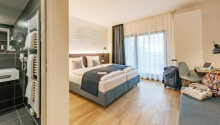 De flotte og rummelige værelser tilbyder 4-stjernede rammer for Jeres ophold