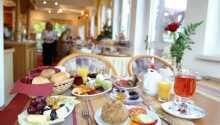 Start dagen med dejlig morgenmad i hyggelige rammer.