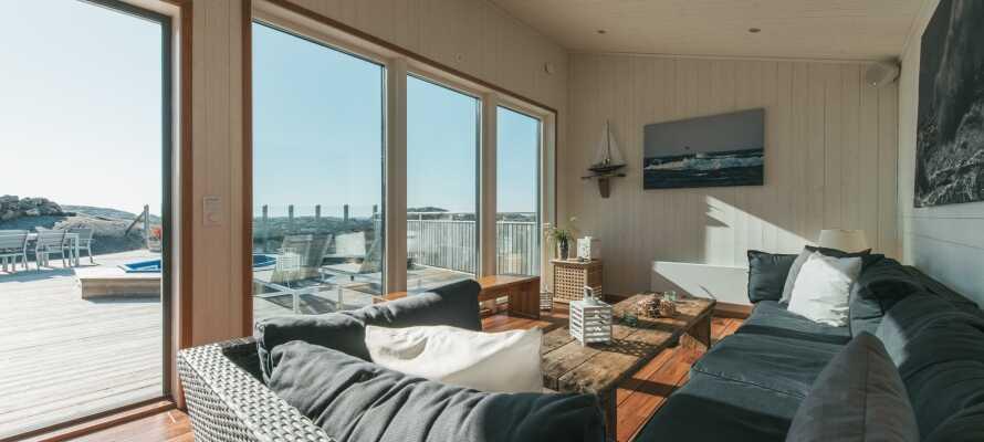 I bliver indlogeret i en lækker arkitektdesignet og moderne familielejlighed med plads til syv personer