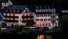 Das Moselhotel & Restaurant Traube genießt eine hervorragende Lage direkt an der Mosel..