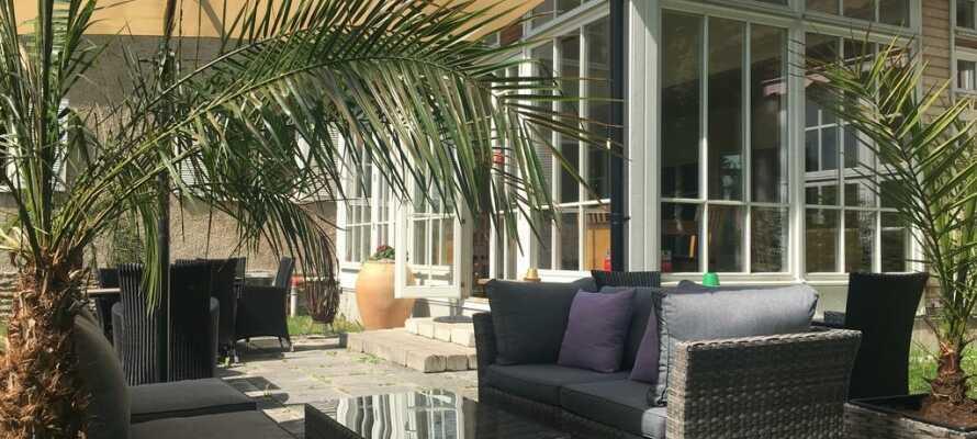 Hotellet er i en flott villa i italiensk stil, og innbyr til avslapning.