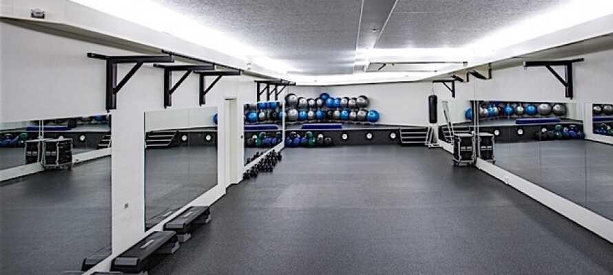 Trainieren Sie Im hoteleigenen Fitnesscenter.