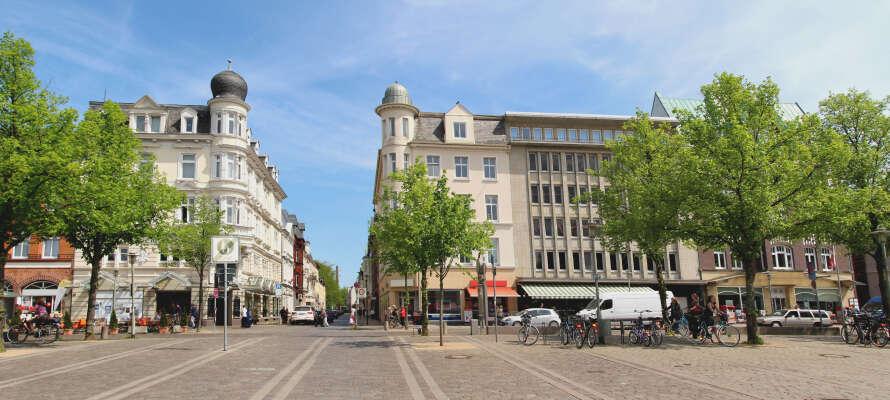 Gå en hyggelig tur gennem det smukke centrum i Neumünster, hvor der er kultur, historie og caféliv på menuen.
