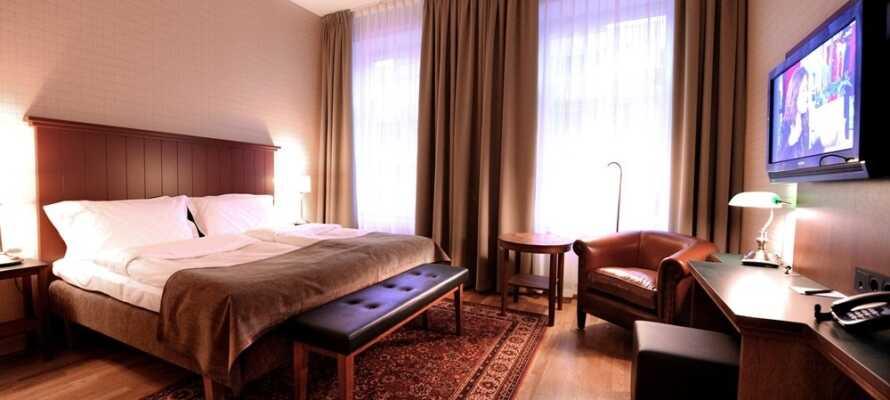Dette hyggelige hotellet har en sentral beliggenhet i Köping i Sverige, og her er det 'Hästens'-senger på alle rommene.
