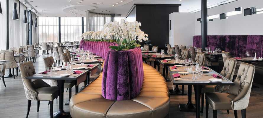 Smaka på utsökta belgiska rätter i hotellet restaurang som heter L'Atelier