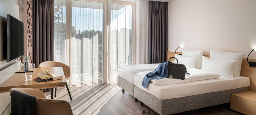Genießen Sie Ihren Aufenthalt in neuen, modern eingerichteten Zimmern.