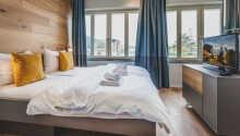 Im Schlafbereich der Apartments wartet moderner Komfort auf Sie.