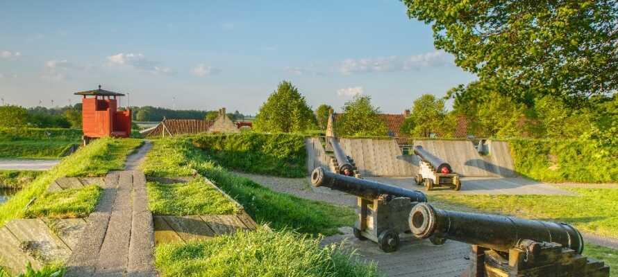 Besøk den nederlandske festningsbyen, Bourtange, hvis hus i dag brukes som museumsbygninger.